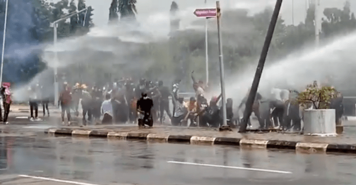 ENDSARS: See Video Of Moment Police Fired Protesters With Live Bullets, Teargas, And Hot Water In Abuja