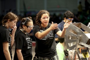 Students from a local team evaluate their robot's performance at last year's Alamo FIRST competition.