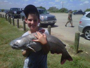(Image) Nine-year-old Patrick Walls shows off the catfish he recently hooked at Calaveras Lake.