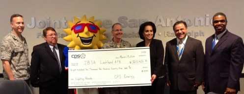 Col. William Eger, Andres Hinojosa, Brig. Gen. Robert LaBrutta, Jelynne LeBlanc-Burley, Elias Abulahad and CPS Energy's Garrick Williams celebrate JBSA's lighting rebate for retrofits at 129 Lackland AFB buildings.