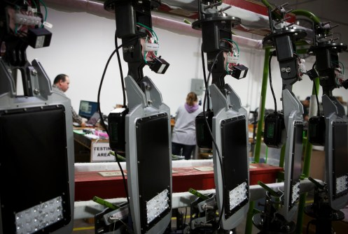 Employees at GreenStar's assembly plant test new LED street lights.