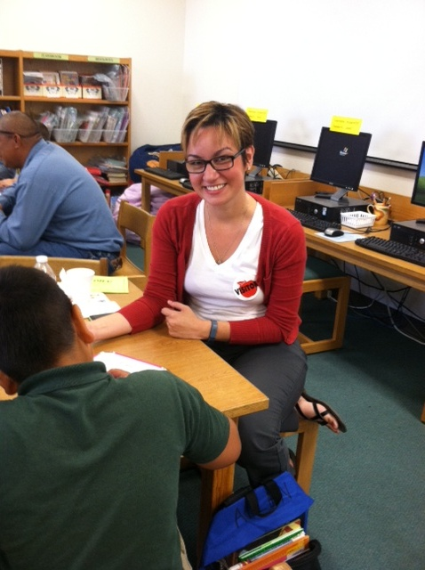 (Image) Reading Buddy Ann Martinez reads with her student at Arnold Elementary.