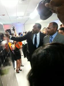 (Image) CPS Energy CEO Doyle Beneby signs a solar panel fresh off the line while Trustee Derrick Howard looks on.