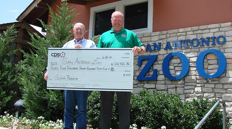 (Image) S.A. Zoo's Steve McCusker and CPS Energy's John Barrow show off rebate check for Zoo's recent solar installation.