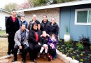 (Image) The Rodriguez family poses in front of their upgraded home thanks to a KENS 5/CPS Energy Mi Casa Makeover.