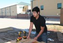 (Image) Robert Muniz builds a window frame for a micro-home at the Construction Careers Academy.
