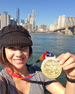 Carla celebrates finishing the New York City Marathon.