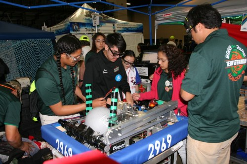 Team Aftermath troubleshoots a last-minute issue before competition.