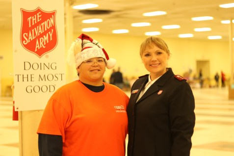 (Image) BeBe Bermudez (left), UED Foreman of our Northwest Service Center, and Salvation Army Captain Jana Griffin (right) help out during the final hours of toy distribution at Salvation Army's toy shop.