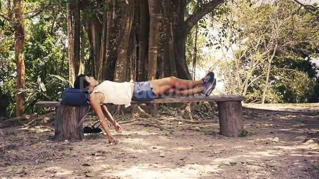 female-hiker-resting-on-a-wood-bench_4ylfxuheo__PM13-07-20