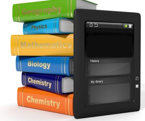 tablet in front of textbooks