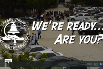 Screenshot from OCDE's earthquake drill video showing employees in the parking lot