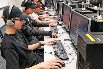 Students on computers participating in online gaming