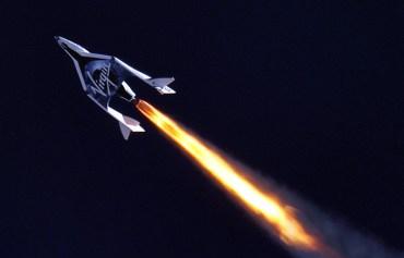 Virgin Galactic's Spaceship 2 flies through the sky