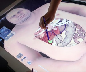 a student performs a simulated surgery on an interactive screen