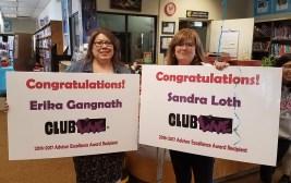 Friday Night Live advisors hold congratulatory signs
