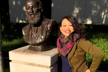 Dr. Tingtangco-Cubales with a bust of Paulo Freire