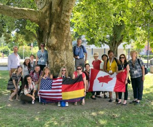 Educators outside with U.S., German and Canadian flags