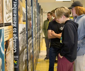 "Students inspect ""The Courage to Remember"" traveling Holocaust exhibit"