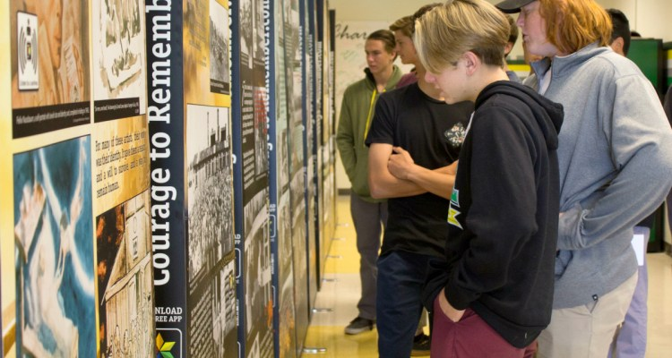 """Students inspect """"The Courage to Remember"""" traveling Holocaust exhibit"""