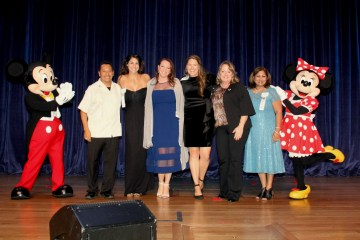 The six Orange County Teachers of the Year finalists with Mickey and Minnie Mouse