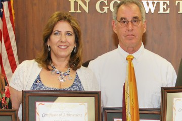 Karen Allison poses Norman Dobrofsky classified employees of the year
