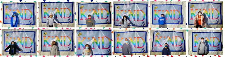 kids in front of kindness banner