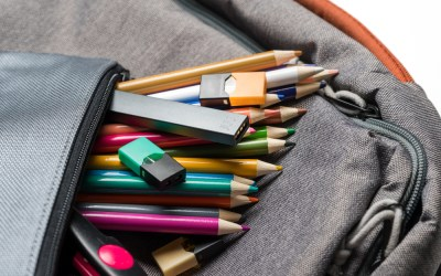 Backpack bag with pencils and vape stick