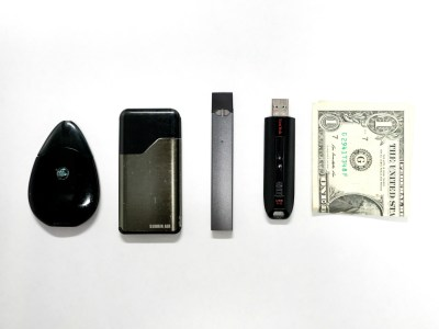Vape devices and a folded dollar bill
