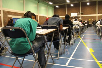 students taking a test in a gym