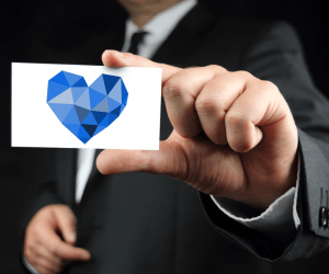 kindness heart, man in suit holding business card