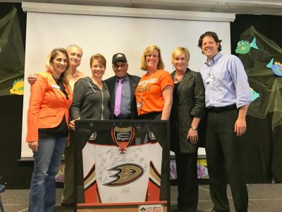 Staff members from Star View Elementary school pose with Willie O'Ree
