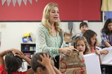 Courtney Smith asks her students to pay attention as she wraps up her lesson