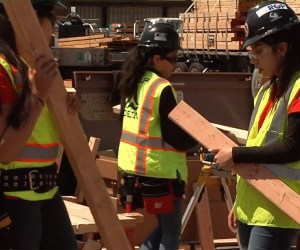 Students working on a construction site