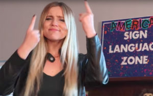 Deaf and hard of hearing student uses sign language to repeat music lyrics