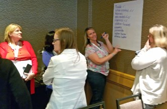 A group of educators write down ideas during an exercise