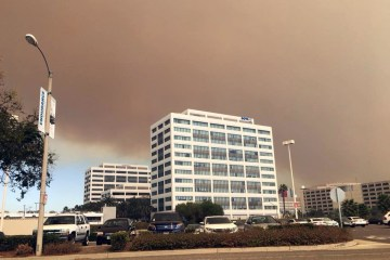 Smoke billows over building in Orange
