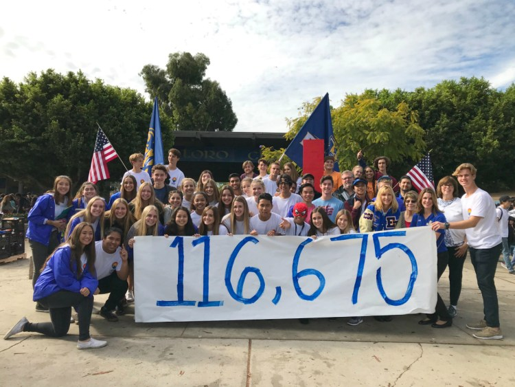 """El Toro High students hold a banner that reads """"116,657"""""""