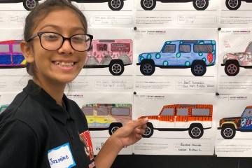 Student Jazmine Alvarado points to her tiger design for an SUV
