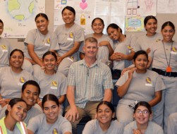 Allen Witten, teacher at Sunburst Academy, surrounded by students