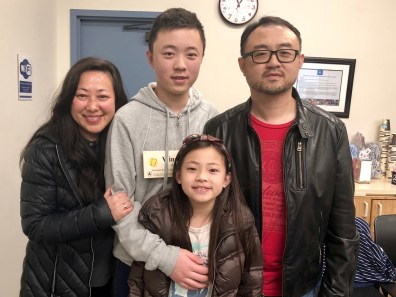 Orange County Spelling Bee winner Winston Zao and his family
