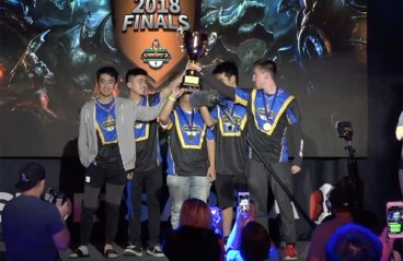 students hold up trophy after winning tournament