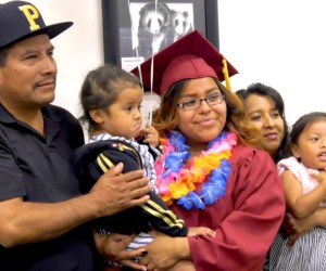 A graduate with her family