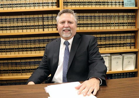 attorney sitting at desk