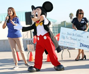 Mickey Mouse greets students
