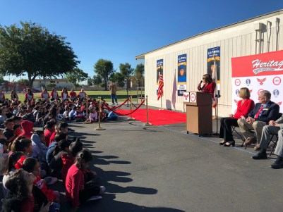 Principal Michelle Pinchot addresses students and parents