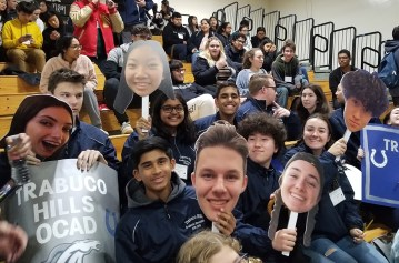students cheer in gym
