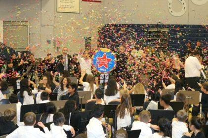 Students celebrate with confetti