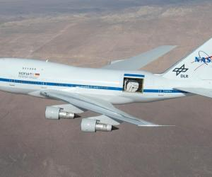 A modified jetliner used for space exploration flies above the ground