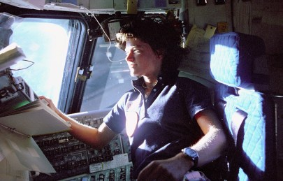 Sally ride in the cockpit of the space shuttle